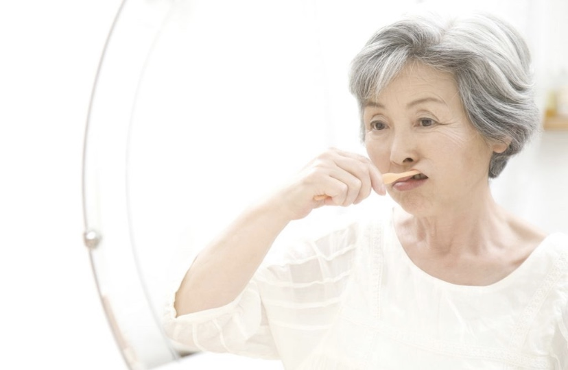 For patients who have suffered loss of mobility, geriatric dentists might suggest modifying toothbrushes to improve the grip. PHOTO ISTOCKPHOTO
