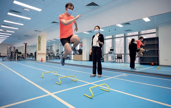 At its new home in Outram Community Hospital, the department boasts gyms and state-of-the-art equipment. The racing track (above) is not just for patients with sports-related issues but also for those with conditions like Parkinson's and stroke. A mirror alongside the track provides feedback for body posture and biomechanical alignment.